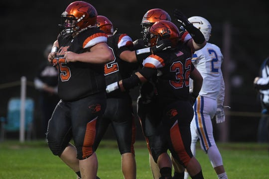 The Lucas Cubs flexed their muscles in a 58-7 win over Steubenville Central Catholic on Friday night.