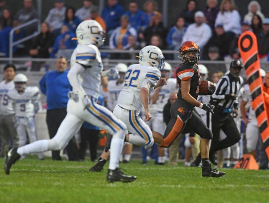 Lucas' Ethan Sauder runs for a big gain Friday night during a game with Steubenville Catholic Central.