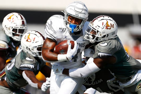 Memphis wide receiver Antonio Gibson breaks past ULM linebacker Rashaad Harding, right, and cornerback Josh Newton at Malone Stadium in Monroe, La on Saturday, Oct. 5, 2019.