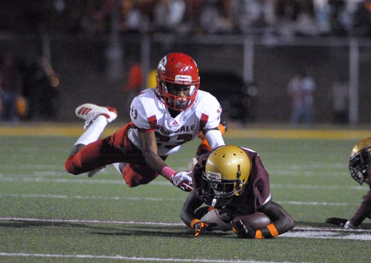 Wooddale's Jacorian Summers (23) tackles Melrose's Devin Thomas (6) during the game at Melrose Stadium Friday, Oct. 4, 2019.