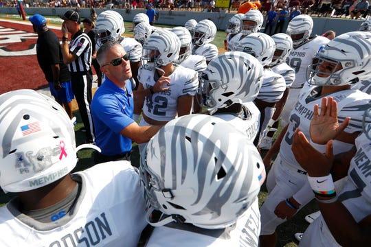 Memphis head coach Mike Norvell leads his team onto the field for their game against ULM at Malone Stadium in Monroe, La., on Saturday, Oct. 5, 2019.