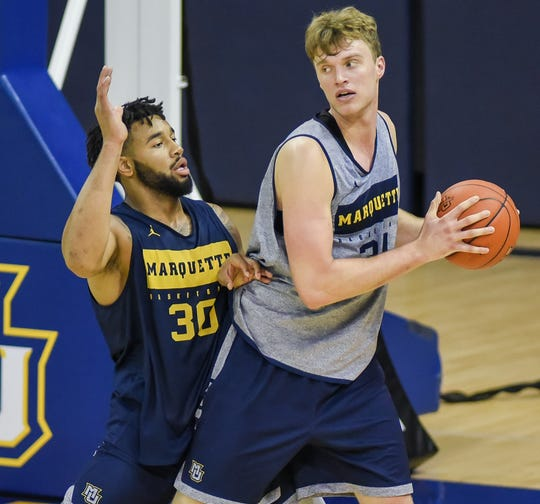 Center Jayce Johnson works the ball inside against forward Ed Morrow during Marquette's open practice Saturday at the Al McGuire Center.