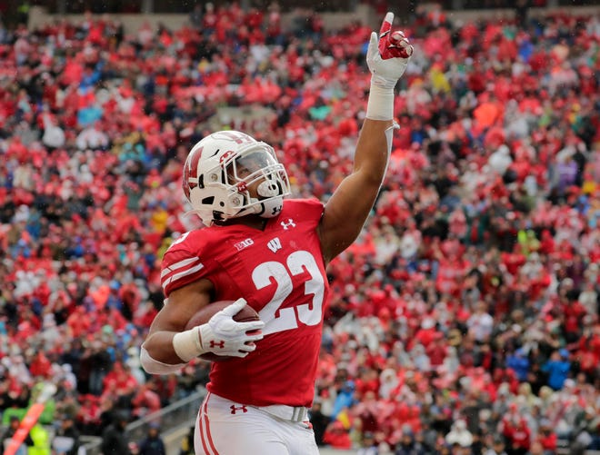 Badgers running back Jonathan Taylor celebrates one of his five touchdowns on the day against Kent State.