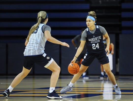 Junior guard Selena Lott, right, and freshman guard Jordan King, left, will be key players for Marquette this season.