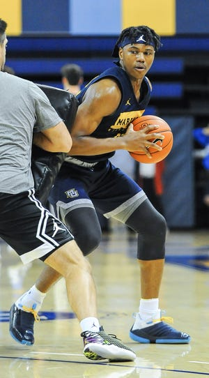 Guard Dexter Akanno looks to make a pass at Marquette University basketball practice Saturday, October 5, 2019, at the Al McGuire Center.