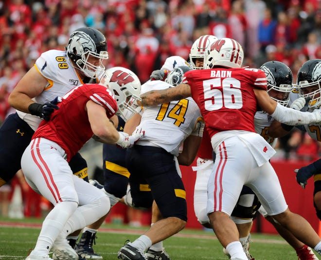 Linebackers Noah Burks and Zack Baun wrap up Kent State  quarterback Dustin Crum for one of Wisconsin's nine sacks Saturday. Through five games, the Badgers have 21, more than all of last season.