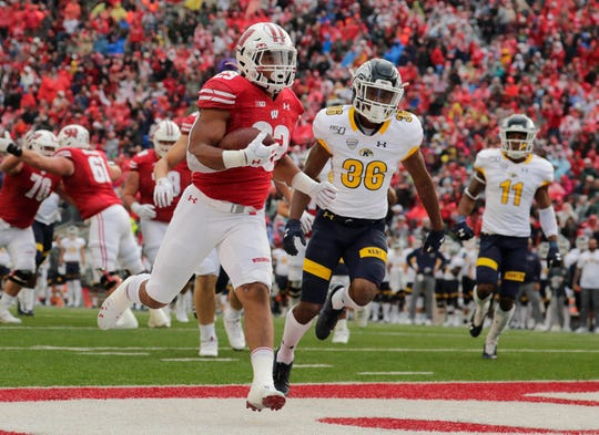 Wisconsin Badgers running back Jonathan Taylor (23) scores his second touchdown of the afternoon during the game against Kent State at Camp Randall Stadium in Madison.
