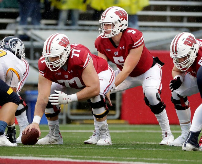 Center Blake Smithback (77) saw his first action as a Badger on Saturday after redshirting during the 2017 season and sitting out last year after suffering a gruesome knee injury during spring camp in '18.