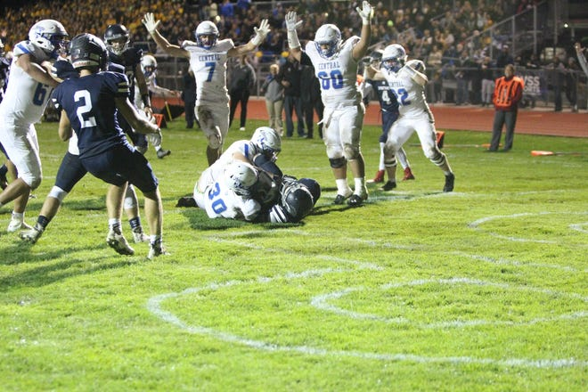 Brookfield Central's Cam Devine (7) and Zik Okoro (60) celebrate the touchdown scored by Rashad Lampkin (30) during the first half of Central's victory over Brookfield East on Friday, Oct. 4, 2019 at East. The grass field at East will be replaced with artificial turf as part of a $5.4 million athletic facilities improvement project in the Elmbrook School District.