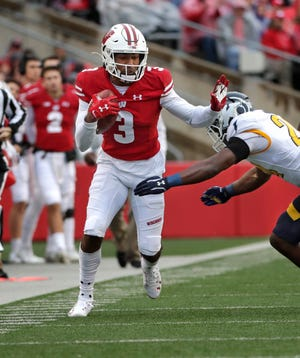 Badgers wide receiver Kendric Pryor makes a catch to set up a touchdown against Kent State on Oct. 5.