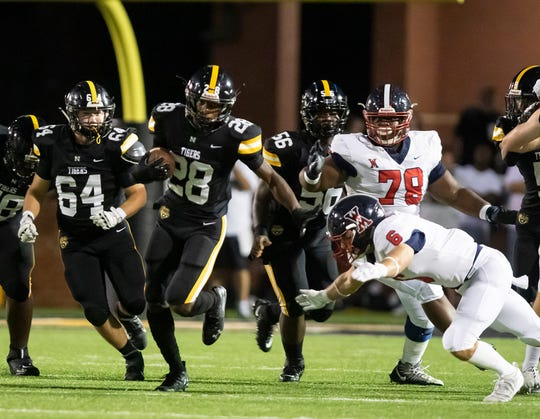 Running back A.J. Allen (28) breaks the line of scrimmage in Neville's 41-14 loss to West Monroe last Friday night at Bill Ruple Stadium.