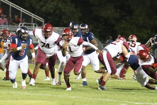 Ouachita running back Chaunzavia Lewis breaks the line of scrimmage in a 35-26 win over Bastrop.