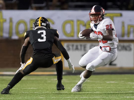 Neville's Joshua Hopkins (3) looks to make the stop on West Monroe's Derome Williams (20) on the opening kickoff of the game at Bill Ruple Stadium in Monroe, La. on Oct. 4.