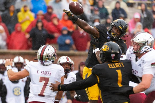 Missouri linebacker Nick Bolton, top right, blocks the pass of Troy quarterback Kaleb Barker, bottom, left, during the first half of an NCAA college football game Saturday, Oct. 5, 2019, in Columbia, Mo. (AP Photo/L.G. Patterson)