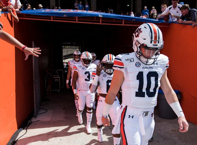 Auburn quarterback Bo Nix (10) leads teammates onto the field before a game against Florida at Ben Hill Griffin Stadium in Gainesville, Fla., on Saturday, Oct. 5, 2019.