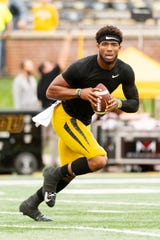 Missouri quarterback Kelly Bryant warms up before the start of an NCAA college football game against Troy Saturday, Oct. 5, 2019, in Columbia, Mo. (AP Photo/L.G. Patterson)
