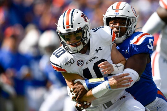 Oct 5, 2019; Gainesville, FL, USA; Florida Gators linebacker Chase Whitfield (53) tackles Auburn Tigers quarterback Bo Nix (10) during the first quarter at Ben Hill Griffin Stadium. Mandatory Credit: Douglas DeFelice-USA TODAY Sports