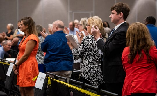 Members of the State Democratic Executive Committee clap for representatives of the DNC attending a called meeting of the SDEC in Montgomery, Ala., on Saturday October 5, 2019.