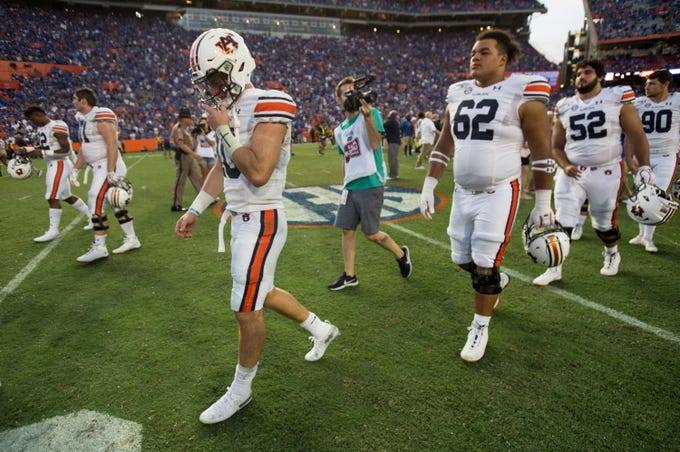 Auburn quarterback Bo Nix (10) walks off the field after the game at Ben Hill Griffin Stadium in Gainesville, Fla., on Saturday, Oct. 5, 2019. Florida defeated Auburn 24-13.