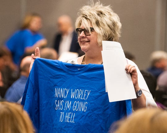 State Democratic Executive Committee member Susan Cobb shows off a popular shirt during a called meeting of the SDEC in Montgomery, Ala., on Saturday October 5, 2019.