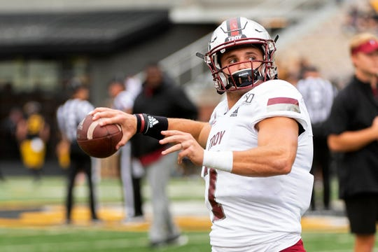 Troy quarterback Kaleb Barker warms up before the start of an NCAA college football game against Missouri Saturday, Oct. 5, 2019, in Columbia, Mo. (AP Photo/L.G. Patterson)