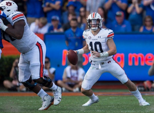 Auburn quarterback Bo Nix (10) looks to pass at Ben Hill Griffin Stadium in Gainesville, Fla., on Saturday, Oct. 5, 2019. Florida leads Auburn 17-13 at halftime.