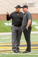Missouri head coach Barry Odom, left, and Troy head coach Chip Lindsey, right, talk before the start of an NCAA college football game Saturday, Oct. 5, 2019, in Columbia, Mo. (AP Photo/L.G. Patterson)