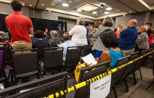 Members of the State Democratic Executive Committee give themselves a standing ovation after they voted on a new set of bylaws during a called meeting of the SDEC in Montgomery, Ala., on Saturday October 5, 2019.