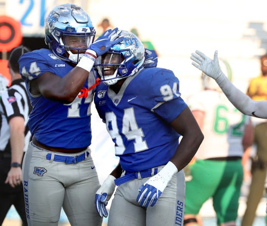 MTSU running back Chaton Mobley (44) congratulates MTSU defensive end Tyshun Render (94) for an interception that ended the game against Marshall on Saturday Oct. 5, 2019, at MTSU.