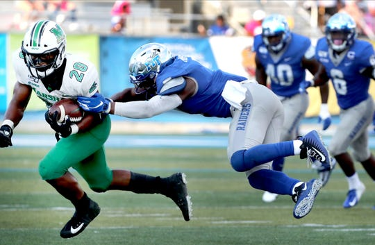 MTSU safety Jovante Moffatt (7) tackles Marshall running back Brenden Knox (20) last season.
