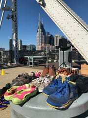 Empty children's shoes on the John Seigenthaler Pedestrian Bridge remembers the Nashville children killed as a result of domestic violence. The display was part of the annual Meet Us at the Bridge event put on by the Nashville Coalition Against Domestic violence on Oct. 5, 2019.