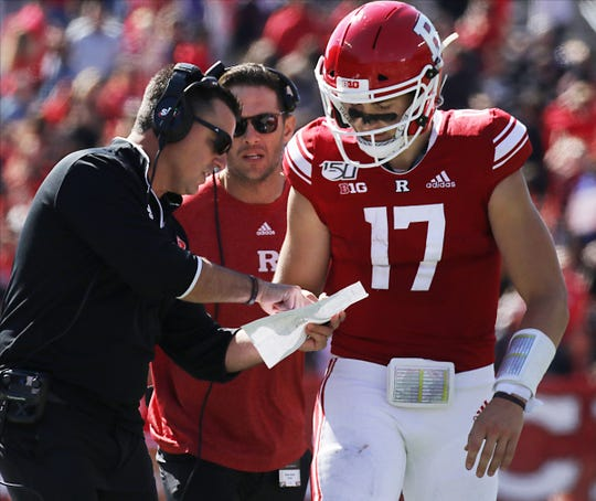On the Rutgers sideline is former Bergen Catholic coach and newly named interim head coach of Rutgers football, Nunzio Campanile with his quarterback Johnny Langan as the Scarlet Knights take on Maryland.