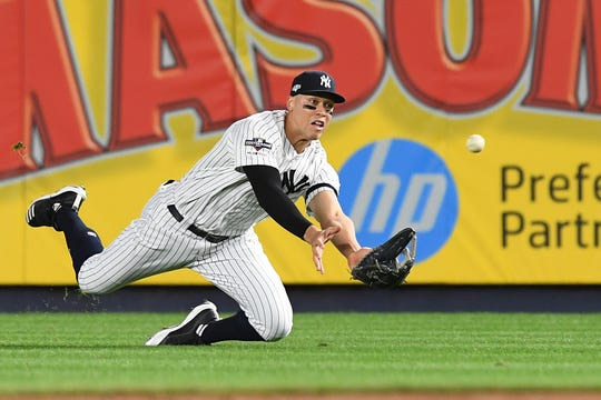 New York Yankees vs. Minnesota Twins in Game 1 of the ALDS at Yankee Stadium on Friday, October 4, 2019. NYY #99 Aaron Judge on his way to making a catch in the third inning.
