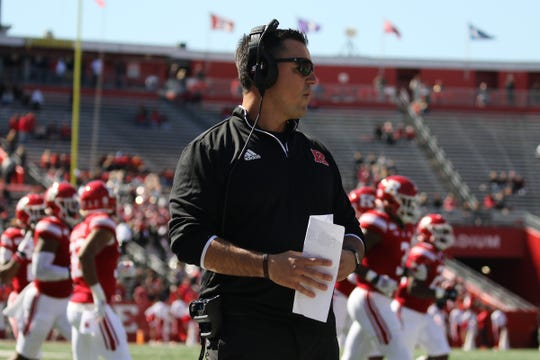 A myriad of empty seats can be seen behind Rutgers coach Nunzio Campanile during the Maryland game.