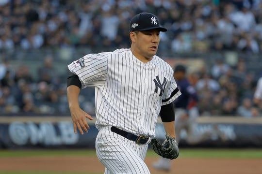 New York Yankees starting pitcher Masahiro Tanaka runs to make a play at first base during the first inning of Game 2 of the American League Division Series baseball game against the Minnesota Twins, Saturday, Oct. 5, 2019, in New York.