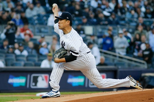 Oct 5, 2019; Bronx, NY, USA; New York Yankees starting pitcher Masahiro Tanaka (19) throws against the Minnesota Twins in the first inning in game two of the 2019 ALDS playoff baseball series at Yankee Stadium.