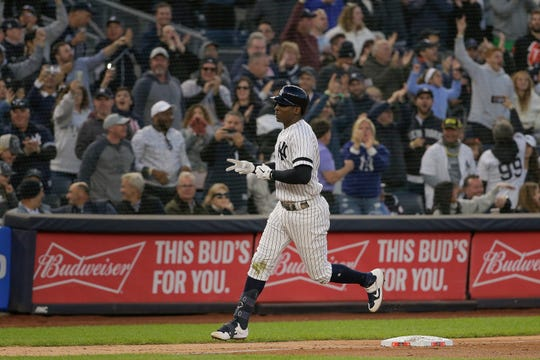 New York Yankees' Didi Gregorius rounds the bases after hitting a grand slam home run against the Minnesota Twins during the third inning of Game 2 of the American League Division Series  Saturday, Oct. 5, 2019, in New York.