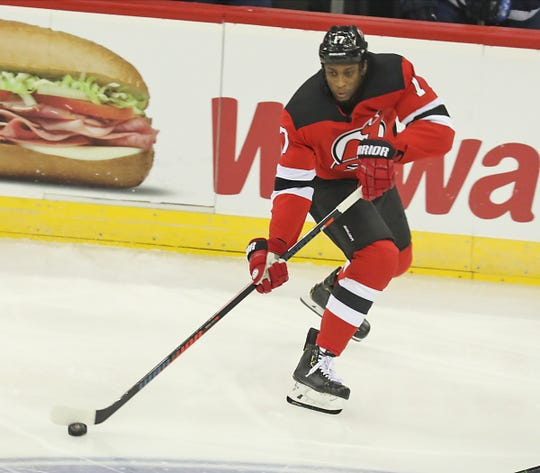 Wayne Simmonds of the Devils carries the puck through the neutral zone in the first period.