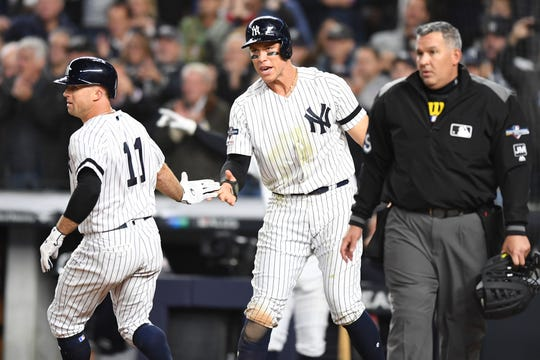 New York Yankees vs. Minnesota Twins in Game 1 of the ALDS at Yankee Stadium on Friday, October 4, 2019. NYY #11 Brett Gardner and #99 Aaron Judge celebrate after scoring in the fifth inning.