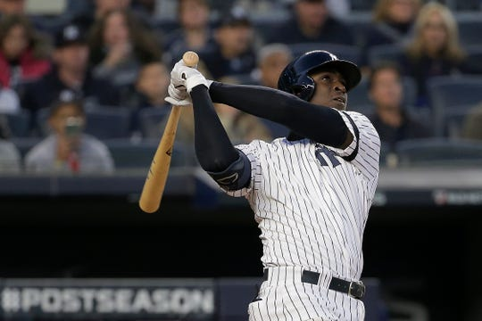 New York Yankees' Didi Gregorius follows through on a grand slam home run against the Minnesota Twins during the third inning of Game 2 of the American League Division Series  Saturday, Oct. 5, 2019, in New York.