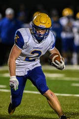 High school football game between Lyndhurst and New Milford in New Milford on Friday October 4, 2019. Lyndhurst #2 Piotr Partyla with the ball.