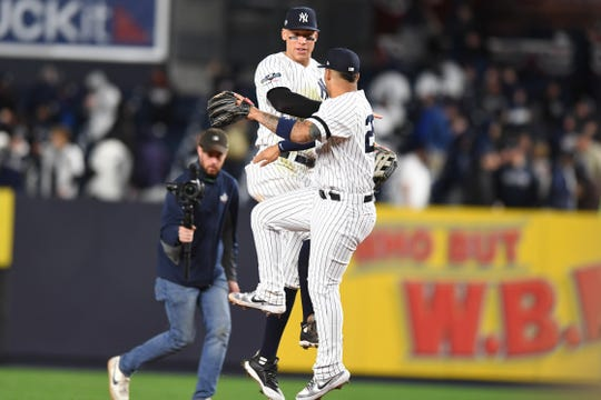 New York Yankees vs. Minnesota Twins in Game 1 of the ALDS at Yankee Stadium on Friday, October 4, 2019. The Yankees celebrate defeating the Twins.