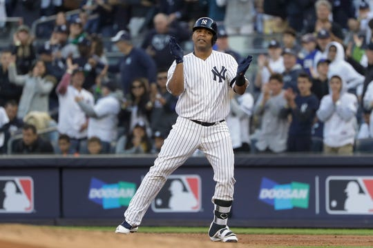 New York Yankees designated hitter Edwin Encarnacion reacts after driving in a run against the Minnesota Twins during the first inning of Game 2 of an American League Division Series Saturday, Oct. 5, 2019, in New York.