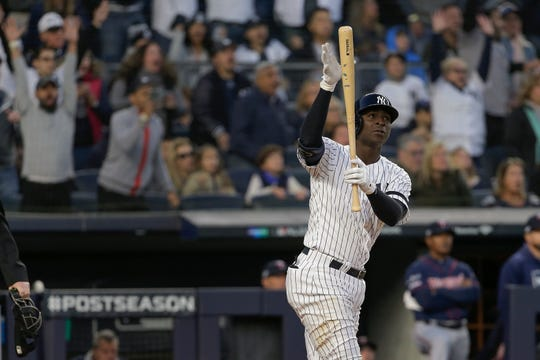 New York Yankees' Didi Gregorius reacts after hitting a grand slam home run against the Minnesota Twins during the third inning of Game 2 of the American League Division Series Saturday, Oct. 5, 2019, in New York.