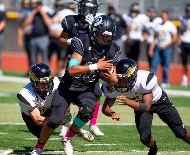 Knight quarterback Matthew Saenz gains yards on a keeper. Onate High School played the Hobbs Eagles on Saturday, September 5, 2019 at the Field of Dreams.