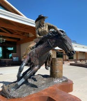 """This life-sized bronze by Albuquerque artist Reynaldo """"Sonny"""" Rivera captures the determination and skill of barrel racer Amberley Snyder. The recently-installed sculpture now greets visitors at the New Mexico Farm & Ranch Heritage Museum."""