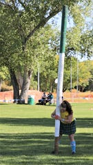 A contestant prepares for a caber toss competition, Saturday, Oct. 5, 2019, during the Aztec Highland Games and Celtic Music Festival at Riverside Park.