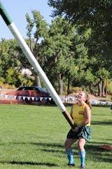 A contestant tosses a caber, Saturday, Oct. 5, 2019, during the Aztec Highland Games.