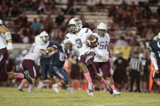 Rancho Mirage's Jevin Dorsey runs the ball during the game in La Quinta, Calif., on Friday, October 4, 2019.