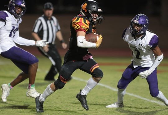 Parker Lyons of Palm Desert runs for a touchdown against Shadow Hils, October 4, 2019.